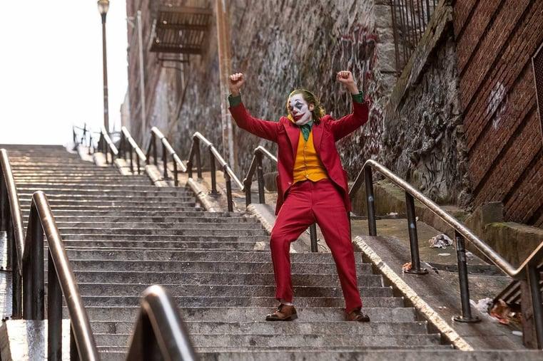 Joaquin Phoenix as the Joker- TimDango Movie Reviews